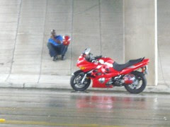 sport biker taking shelter from the rain