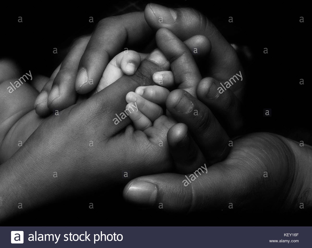 Mother Father And Daughter Holding Hands Showing Support Love And