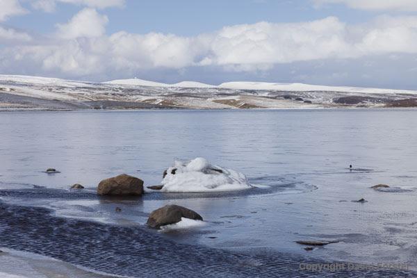 06D-4484 The Snow Covered High Pennine Mountains of Cross Fell Little Dun Fell and Great Dun Fell Viewed Across a Frozen Cow Green Reservoir Upper Teesdale