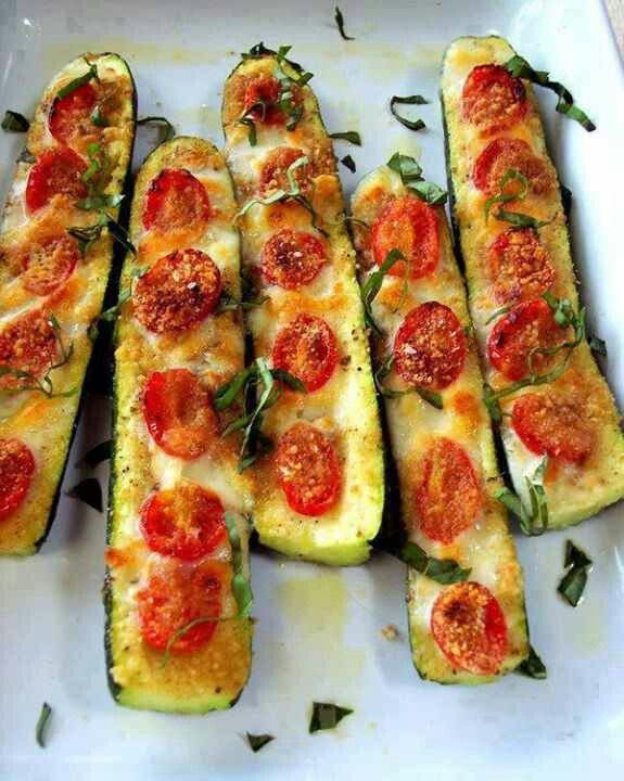 Zucchini Pizza Boats- Slice the zucchini in half. Slice off the bottom to keep in stable. Brush with olive oil and top with garlic or garlic powder. Top with sliced tomatoes, salt and pepper to taste. Use mozzarella cheese, Parmesan cheese or mixed blend.. Bake 375 for 20 to 30 minutes until soft.