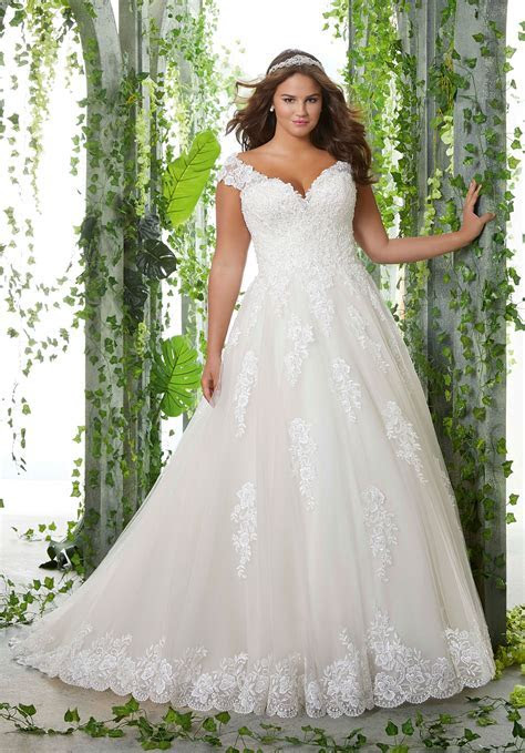 Embroidered Lace Appliqués and Scalloped Hemline with