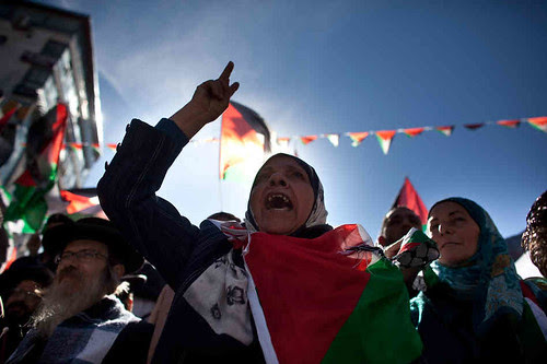 Palestinians in Ramallah demonstrate in support of the United Nations General Assembly vote to recognize the oppressed nation with nonmember status. The UN voted 65 years earlier to recognize Israel. by Pan-African News Wire File Photos