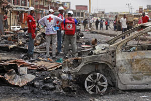 Red Cross personnel search for remains at the site …