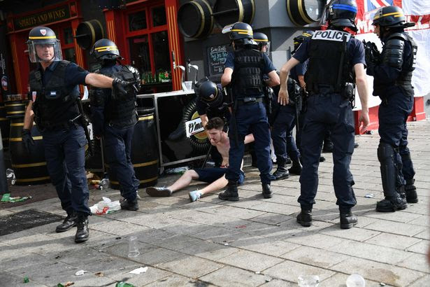 French policeman detain an England fan