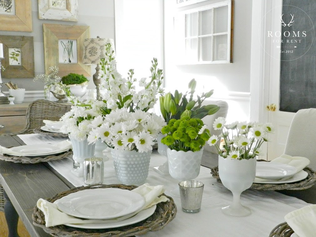 Create a simple, neutral tablescape for spring with grapevine chargers and milk glass filled with daisies like this one from Rooms for Rent | Friday Favorites at www.andersonandgrant.com