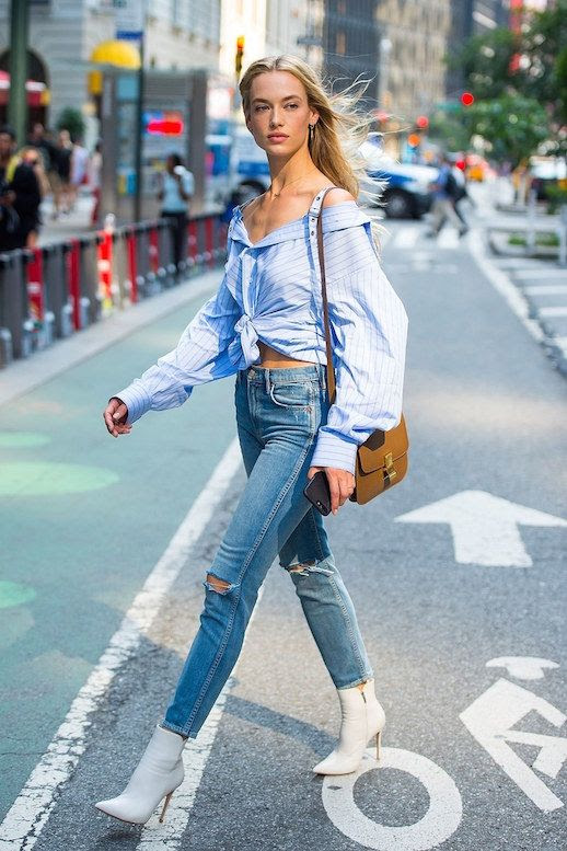 Le Fashion Blog Striped Off The Shoulder Top Distressed Jeans White Heeled Boots Crossbody Bag Via Vogue