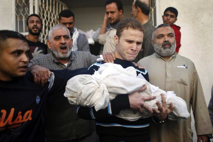 BBC journalist carries his son's body
