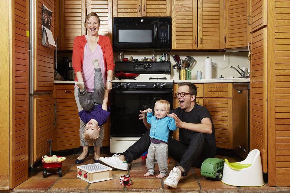 Jason Gay and his wife, Bessie, with their children—Jesse, 2, and Josie, 9 months—on Thursday in their home in Brooklyn, N.Y.