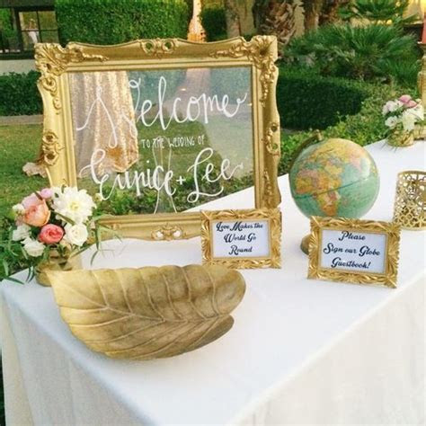 Welcome table with Globe sign in book for guests! Perfect