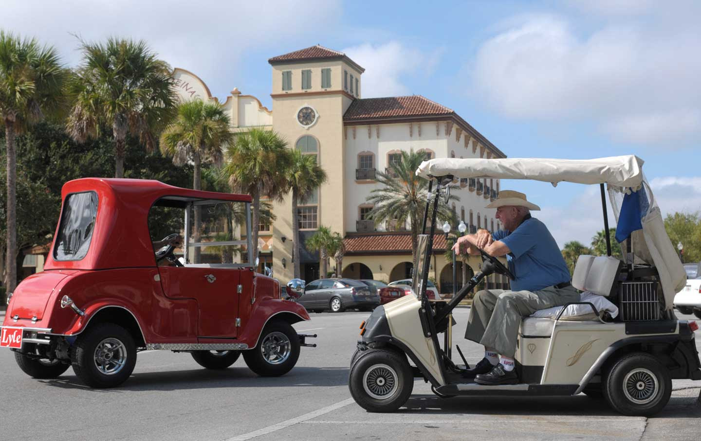 William LeBeau, 86, right, sits in his golf cart in The Villages.
