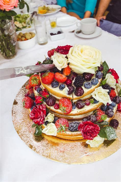 Wedding Cake Decorated By Fruits And Flowers. Stock Photo