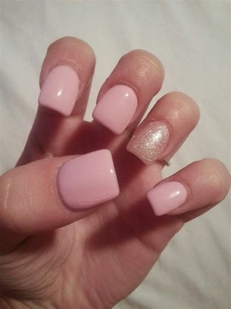 Light pink nails with silver/pink glitter in ring finger