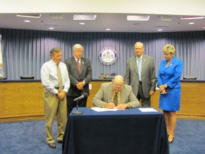 Chairman W.C. Jarman signing Ordinance