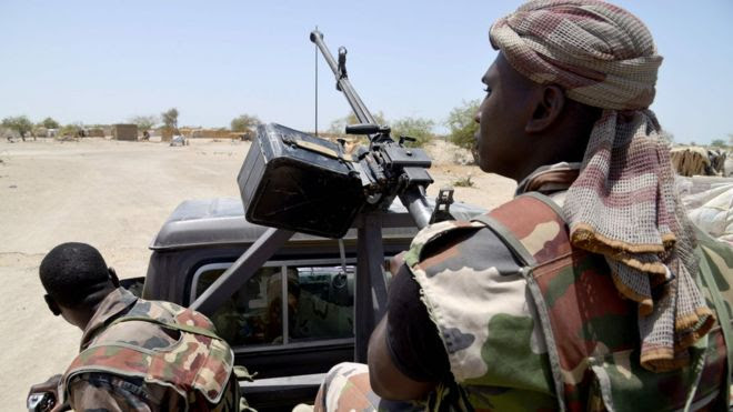 This file photo taken on May 25, 2015 shows Nigerian soldiers patrolling on a road between Diffa and Bosso.