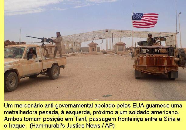 Um mercenário anti-governamental        apoiado pelos EUA guarnece uma metralhadora        pesada, à esquerda, próximo a um soldado americano quando tomam        posições em Tanf, uma passagem fronteiriça entre a        Síria e o Iraque. (Hammurabi's Justice News/AP)