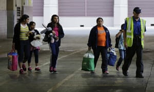 Immigrants from El Salvador and Guatemala who entered the country illegally board a bus after they were released from a family detention center in San Antonio, Texas.