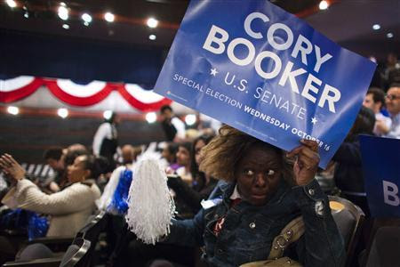 A supporter of U.S. Senate candidate Cory Booker waits for his arrival during his campaign's election night event in Newark, New Jersey, October 16, 2013. REUTERS-Eduardo Munoz