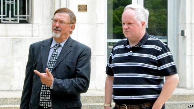 William Melchert-Dinkel, right, and his attorney Terry Watkins leave court in Faribault, Minnesota 8 August 2014