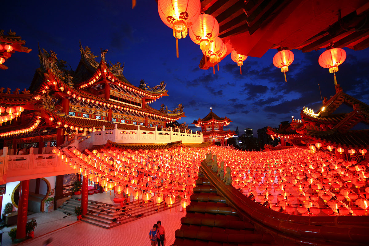 Lanterns are hung in a temple ahead of Chinese New Year celebrations in Kuala Lumpur, Malaysia. Legend has it that red lanterns scared away a mythical beast, and this tale is celebrated every New Year.