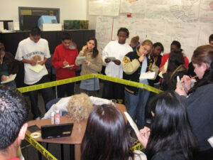 Students study a crime scene during a forensics class at the Center for Advanced Research and Technology.