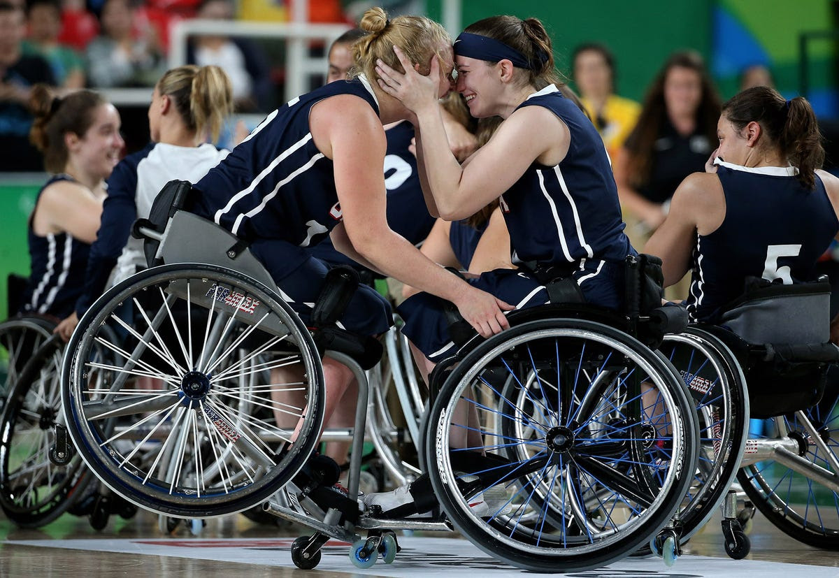 Members of Team USA celebrate winning gold in wheelchair basketball.