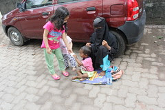 My Grandkids Giving Eidi To The Muslim Beggar Kid- Eid Mubarak To All Of You by firoze shakir photographerno1