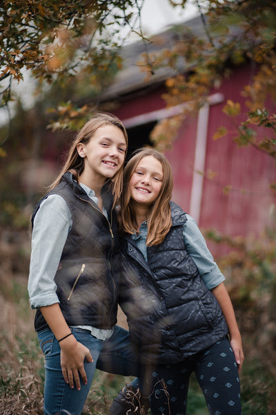 The Hankins family headed to Rock Cut state park in northern Illinois for a relaxed, candid family photo session amongst a pine tree forest, grassy field, and in front of an old red barn.