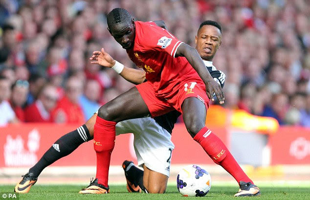 Battle: Mamadou Sakho and Nathaniel Clyne vie for the ball