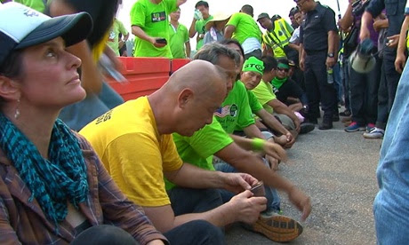 Point of arrest - Natalie is approached by police for 'illegally' protesting against Lynas's controversial plant
