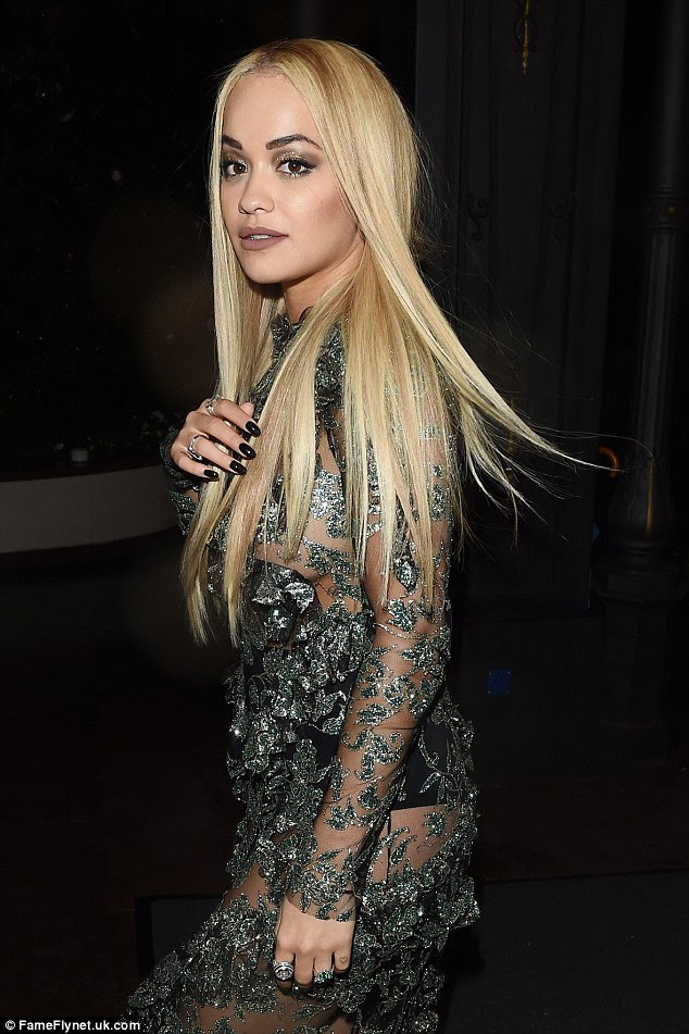 Stunner:The 25-year-old musician, who took to the stage to entertain the guests that evening, teased at her curvaceous form beneath the semi-sheer garment, which used only a foliage lace design to protect her modesty