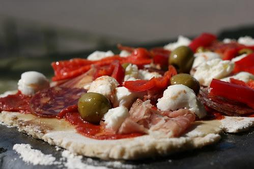 Olive and procuito pizza