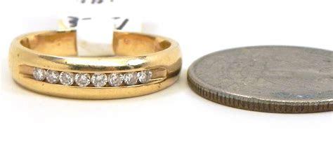 ladies  yellow gold diamonds wedding band bright jewelers
