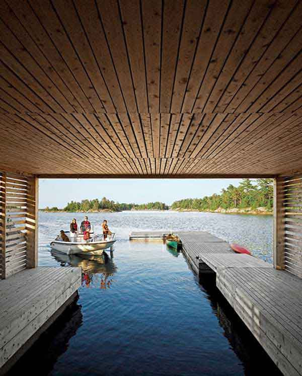Floating-House-with-an-Integrated-Boathouse-and-Dock-5