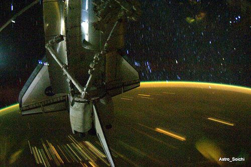 A surreal shot of space shuttle Discovery docked to the International Space Station (ISS), on April 13, 2010.