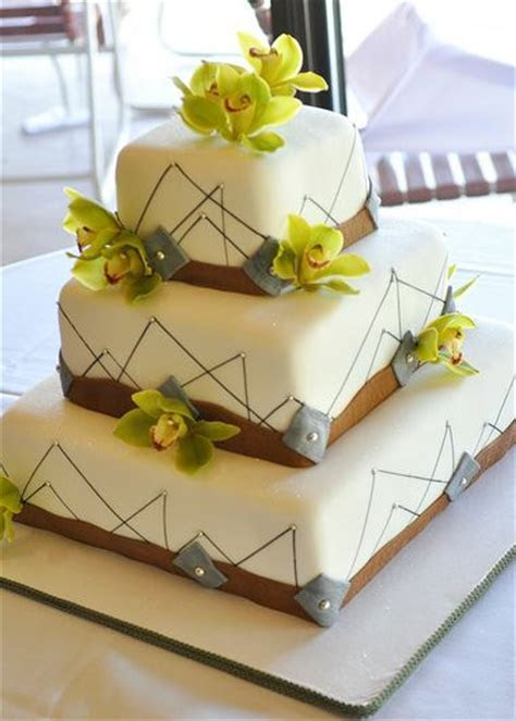 3 tier rectangular white wedding cake with brown bands and