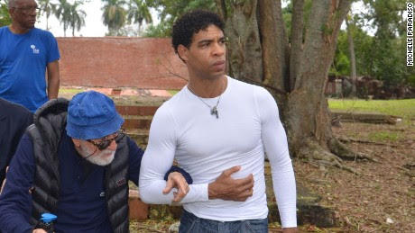 Acosta (right) and Garatti on the grounds of the school in 2015