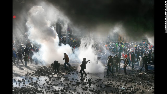 Protesters fight with riot police during a new wave of violent clashes February 18 in Kiev.