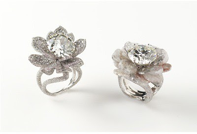 03 A pair of flat diamond and old cut diamond flower petal rings