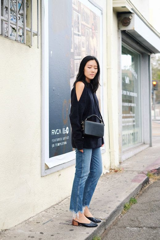 Le Fashion Blog Cold Shoulder Black Sweater Raw Hem Jeans Heeled Mules Via Andy Heart