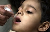 A Pakistani child receives anti-polio vaccine drops in 2004. Pakistani militants in a Taliban and Al-Qaeda infested tribal region Saturday banned anti-polio vaccination teams, to protest US drone strikes saying the attacks were killing civilians