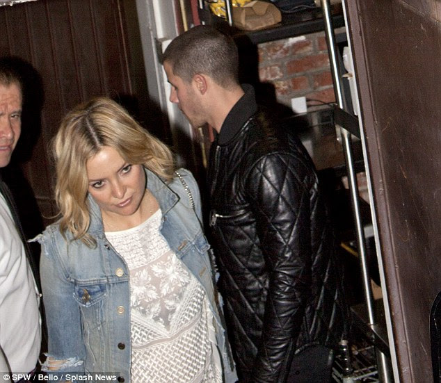 Back on? Kate Hudson and Nick Jonas did little to quash dating rumours when they stepped out for a romantic dinner at Pace Italian restaurant in Los Angeles on Thursday evening