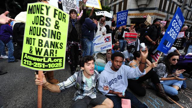 http://i2.cdn.turner.com/cnn/2011/images/10/10/t1larg.occupy-wall-street.t1larg.jpg