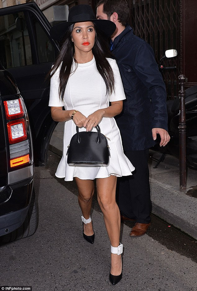 Bridal white: Kourtney wore a cute short dress for the dinner