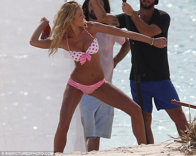 Take that! Candice messes around with one shot as she pretends to throw a clump of seaweed