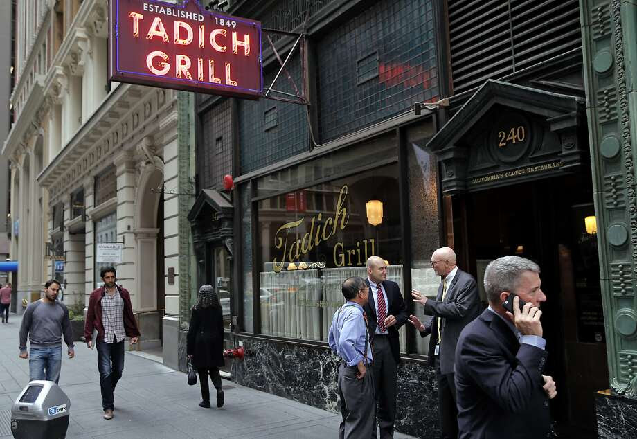 People passing by the Tadich Grill on California St. in San Francisco, Calif. on Tues. October 27, 2015. Photo: Michael Macor, The Chronicle