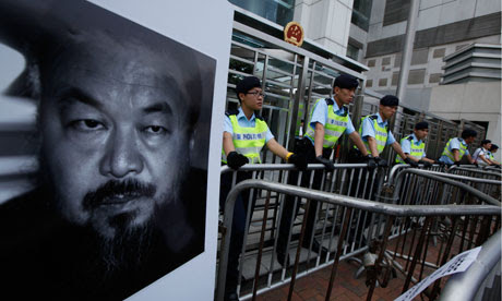 Ai Weiwei's face on a poster placed outside the Chinese liaison office in Hong Kong on 10 April