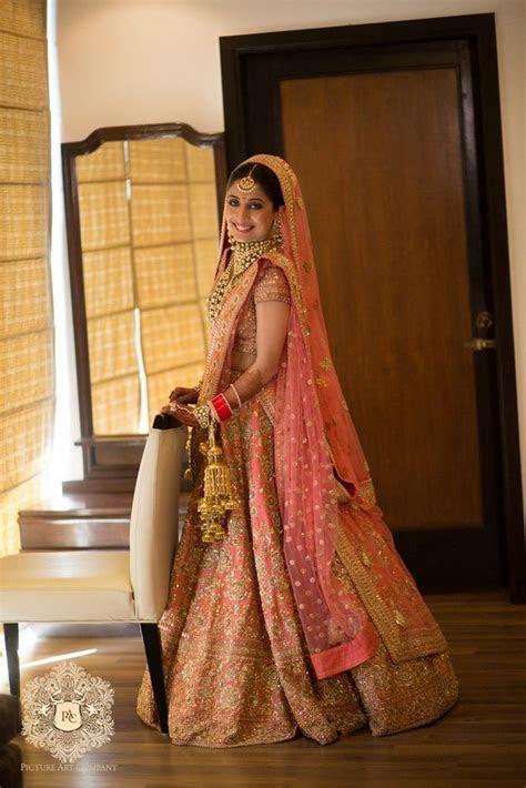 Coral pink bridal lehenga by Sabyasachi   Wedding bride