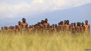 M23 rebel recruits stand at attention during a training session at the Rumangabo military camp in the eastern Democratic Republic of Congo on 16 May, 2013.