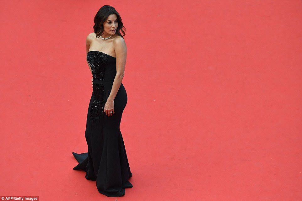 On the crimson runway: Eva made sure to make the most out of her time on the red carpet, her black gown a stark contrast against the backdrop