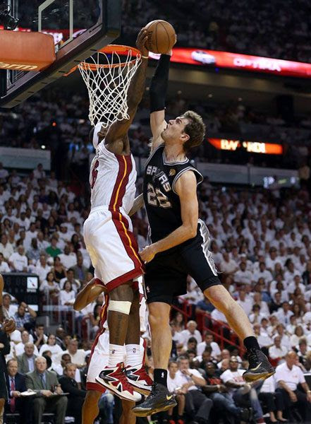LeBron James blocks a dunk attempted by Tiago Splitter during the Miami Heat's Game 2 victory against the San Antonio Spurs on June 9, 2013.